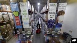 Pallets of various foods are stacked on shelves in the extensive warehouse at the Houston Food Bank Wednesday, Oct. 14, 2020, in Houston. (AP Photo/Michael Wyke)