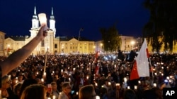 Thousands of anti-government protesters with lit candles gather in front of the Supreme Court in a continuation of protest in Warsaw, Poland, July 16, 2017.