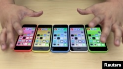 The new iPhone 5C in five colours are placed together at Apple Inc's announcement event in Beijing, September 11, 2013.