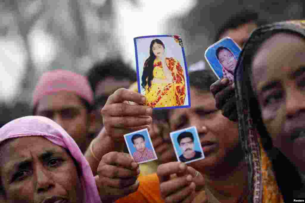 Relatives show pictures of garment workers who are missing, during a protest to demand capital punishment for those responsible for the collapse of the Rana Plaza building, in Savar, outside Dhaka.