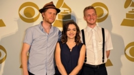 The Lumineers, (L-R) Wesley Schultz, Neyla Pekarek and Jeremiah Fraites pose for a photo backstage at the Grammy Nominations Concert Live! at Bridgestone Arena, Dec. 5, 2012, in Nashville, Tennessee.
