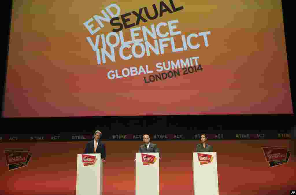 U.S. Secretary of State John Kerry, left, British Foreign Secretary William Hague, center, and actress Angelina Jolie, right, Special Envoy of the United Nations High Commissioner for Refugees, attend their joint news conference at the conclusion of the of the 'End Sexual Violence in Conflict' summit in London.