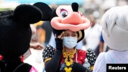 A woman costumed as Minnie Mouse wears a mask to prevent against the spread of coronavirus disease (COVID-19), as the highly transmissible Delta variant has led to a surge in infections, in New York City, U.S., July 30, 2021.