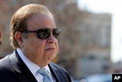 FILE - Dr. Salomon Melgen arrives at the Martin Luther King Jr. Federal Courthouse for his arraignment, in Newark, N.J., April 2, 2015.