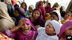 FILE - Pakistani Christian women mourn the death of a man killed in a bombing attack, in Lahore, March 28, 2016. A suicide bombing had targeted Christians gathered on Easter, the day before, in Lahore. Christians frequently complain of being harassed by radicals in Pakistan.