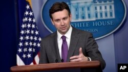 FILE - White House press secretary Josh Earnest.