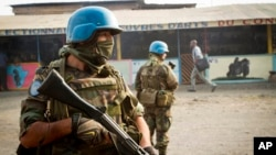 FILE - United Nations peacekeepers from Uruguay patrol a street in Goma, eastern Congo, July 13, 2012.