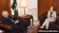 FILE - Adviser to Pakistan's Prime Minister on Foreign Affairs Sartaj Aziz meets with the Acting U.S. Special Representative for Afghanistan and Pakistan, Laurel Miller, in Islamabad, Dec. 5, 2016.