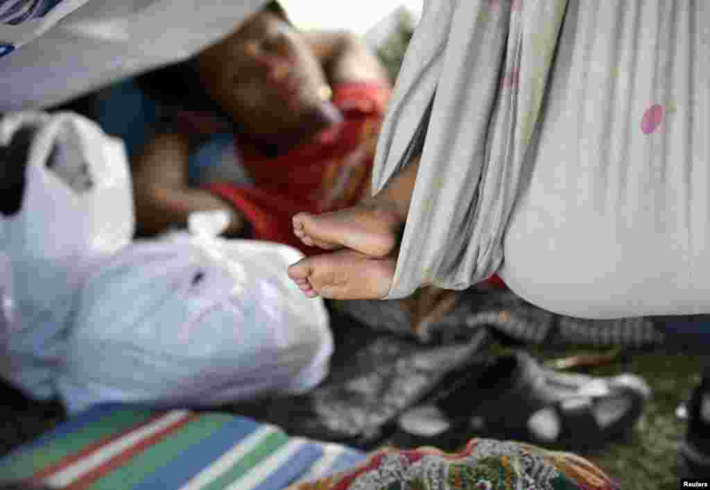 Villagers who fled the fighting between government forces and Muslim rebels rest in their tents along a boulevard in Zamboanga, Philippines, Sept. 18, 2013.