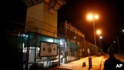 FILE - The entrance to Camp VI detention facility is guarded at Guantanamo Bay Naval Base, Cuba, Nov. 20, 2013.