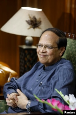 FILE - Recently resigned Bangladesh central bank Governor Atiur Rahman smiles during an interview inside his office in Dhaka, October 2, 2013.