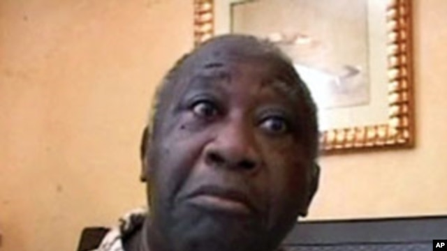 Ivory Coast's Laurent Gbagbo after being arrested, April 11, 2011