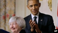 FILE - President Barack Obama applauds as Janet Yellen, vice chair of the Board of Governors of the Federal Reserve System, speaks after the president announced he is nominating Yellen to be chair of the Federal Reserve, succeeding Ben Bernanke, in the St