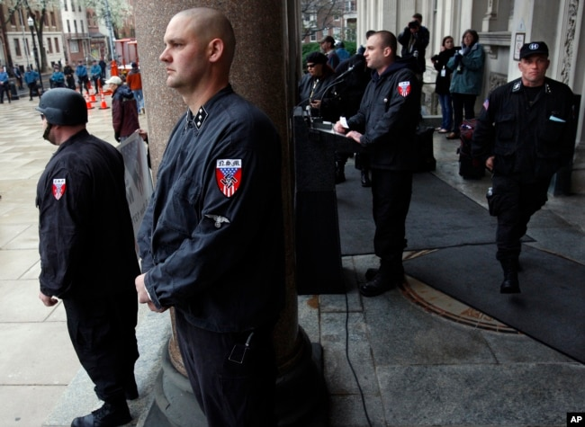 Guards of the neo-Nazi National Socialist Movement stand nearby as Commander Jeff Schoep speaks at a rally, April 16, 2011, on the steps of the Statehouse in Trenton, New Jersey.