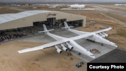 The world's largest plane, called Stratolaunch, is wheeled out of its hangar for the first time on May 31, 2017 at the Mojave Air & Space Port in California. (Stratolaunch Systems)
