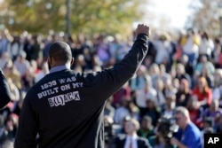 A member of the black student protest group Concerned Student 1950 gestures while addressing a crowd following the announcement that University of Missouri System President Tim Wolfe would resign, Nov. 9, 2015, at the university in Columbia, Missouri.