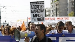 Protesters shout slogans during demonstration in Athens, Oct. 5, 2011