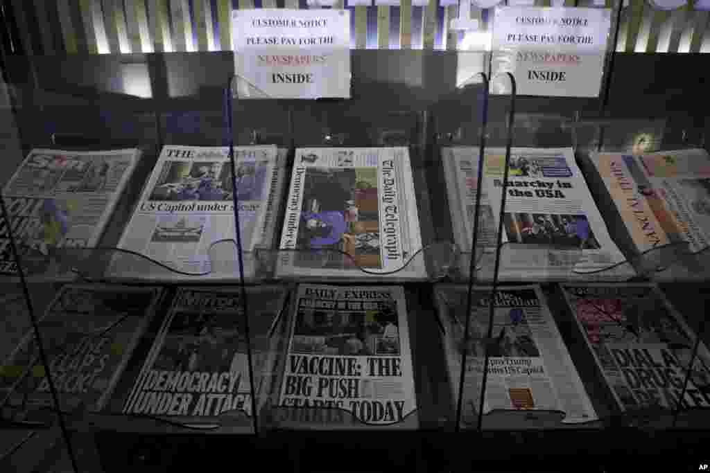 British national newspapers, with front pages reporting on the mob loyal to President Donald Trump storming the U.S. Capitol, are displayed for sale outside a store in London.