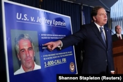 FILE: U.S. Attorney Geoffrey Berman, points to a photograph of Jeffrey Epstein as he announces the financier's charges of sex trafficking of minors and conspiracy to commit sex trafficking of minors, in New York, U.S., July 8, 2019.