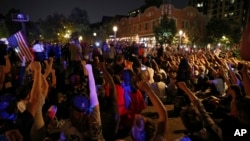 Protesters gather, Sept. 15, 2017, in St. Louis, after a judge found a white former St. Louis police officer, Jason Stockley, not guilty of first-degree murder in the death of a black man, Anthony Lamar Smith, who was fatally shot following a high-speed chase in 2011.