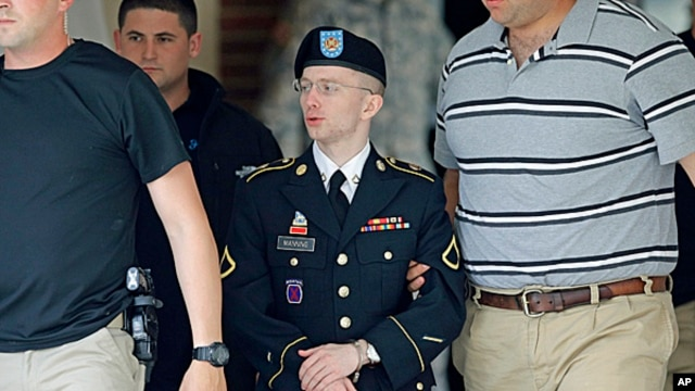 Army Pfc. Bradley Manning, center, is escorted out of a courthouse in Fort Meade, Md.,  June 17, 2013.