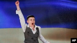 Ukrainian pilot Nadiya Savchenko, who was freed two days earlier from a Russian jail, shouts patriotic slogans as she leaves her news conference in Kyiv, May 27, 2016.