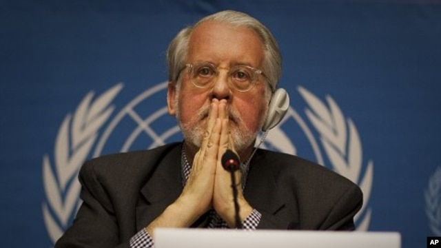 Brazilian Paulo Sergio Pinheiro, who is mandated by the UN Human Rights Council to lead an international investigation of allegations of human rights abuses in Syria, gestures during a press conference at the UN headquarters in Geneva, November 28, 2011.