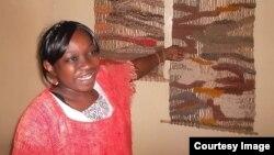 Okello's daughter, Linet Lydia Atieno, displays Kapendeza products (VOA/Ajanga Khayesi)