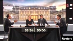 Francois Hollande (izquierda) y el presidente Nicolás Sarkozy (derecha), durante el debate de este miércoles por la noche.