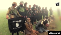 FILE - An image from a purported Islamic State group video showing captives. The recent beheadings of members of the minority Shi'ite Hazara ethnic community sparked protests in Kabul.