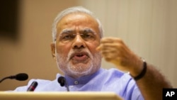 Indian Prime Minister Narendra Modi speaks at the launch of a campaign aimed at opening millions of accounts for poor Indians in New Delhi, Aug. 28, 2014.