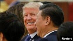 Ông Trump và Chủ tịch Tập Cận BÌnh tại quốc yến ở Trung Quốc cuối năm ngoái.