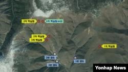 지난해 9월 한국 국방부가 제공한 북한 풍계리 핵실험장 위성 사진. 지난 5차례의 핵실험 지점과, 지하갱도 입구 위치가 표시돼있다.