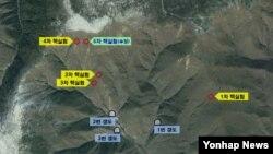 한국 국방부가 제공한 북한 풍계리 핵실험장 위성 사진. 지난 5차례의 핵실험 지점과, 지하갱도 입구 위치가 표시돼있다. 한국 군은 핵실험장 3번 갱도에서 핵실험 준비를 마친 정황을 포착했다고 밝혔다.