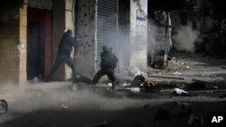 Members of the Palestinian Fateh Movement clash with Islamists in the Palestinian refugee camp of Ein el-Hilweh near the southern port city of Sidon, Lebanon, April 9, 2017.
