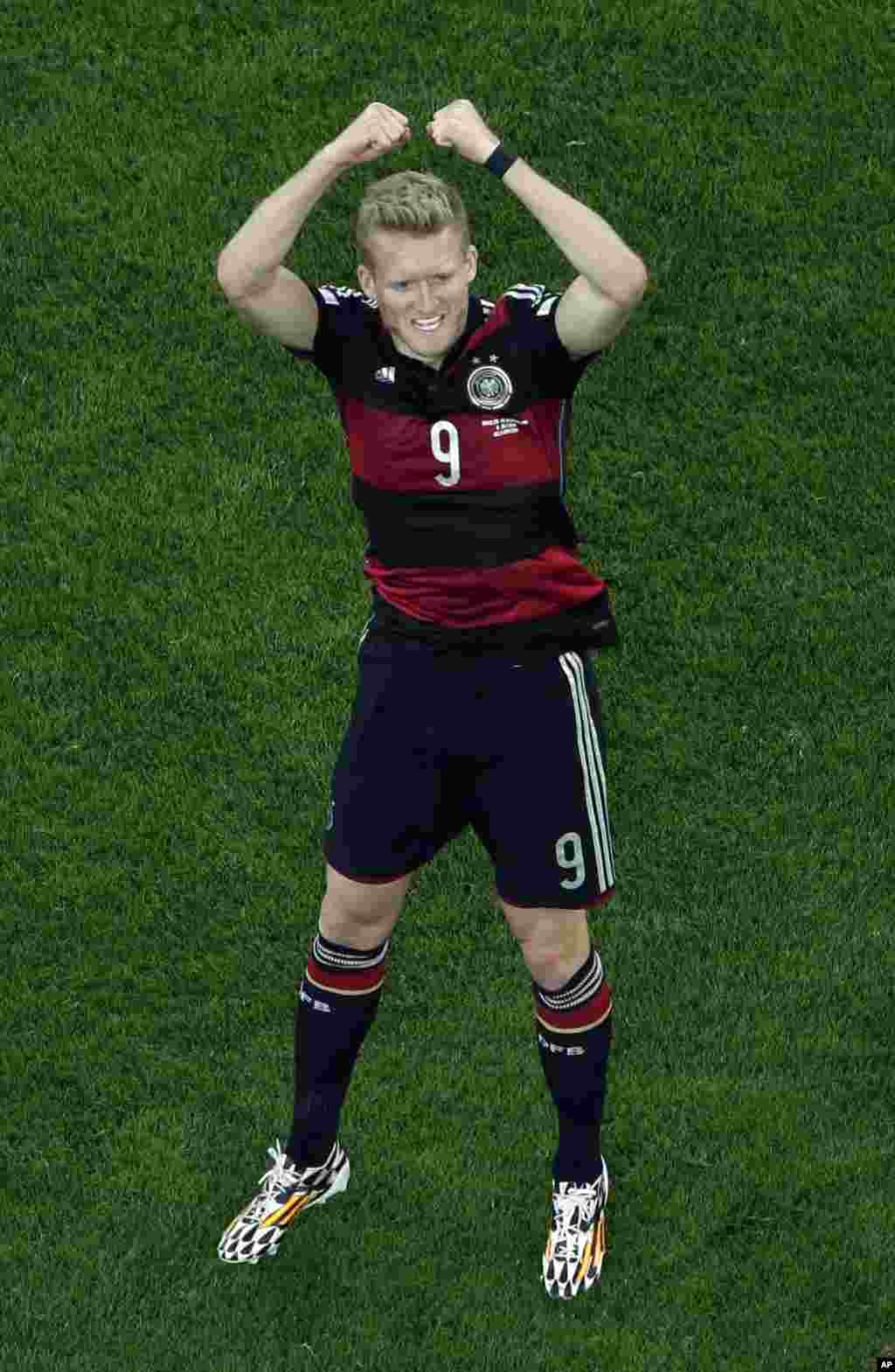 Germany's Andre Schuerrle celebrates scoring his side's 6th goal during the World Cup semifinal soccer match between Brazil and Germany at the Mineirao Stadium in Belo Horizonte, Brazil, July 8, 2014.