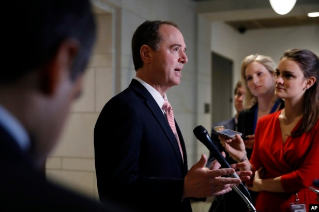 FILE - Rep. Adam Schiff, D-Calif., ranking member on the House intelligence committee, speaks to reporters after the committee interviewed former White House strategist Steve Bannon, Feb. 15, 2018, on Capitol Hill in Washington.