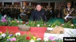 North Korean leader Kim Jong Un attends a wake for the late Korean People's Army General Ri Ul Sol, on Nov. 8, 2015.