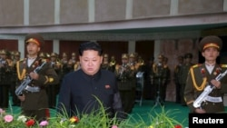 FILE - North Korean leader Kim Jong Un attends the funeral of the late Korean People's Army general Lee Ul Sol, Nov. 8, 2015.