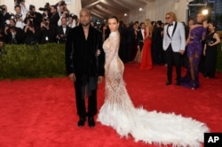 "Kanye West and Kim Kardashian West attend The Metropolitan Museum of Art's Costume Institute benefit gala celebrating ""China: Through the Looking Glass"" on May 4, 2015, in New York."
