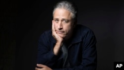 FILE - Jon Stewart poses for a portrait in promotion of his film 'Rosewater.'