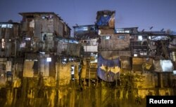 Windows of various shanties in Dharavi, one of Asia's largest slums, are seen in Mumbai, India, Jan. 28, 2015.