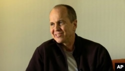 FILE - In this image made from video, Australian journalist Peter Greste speaks during an interview a day after his release from prison in Egypt, in Larnaca, Cyprus, Feb. 2, 2015.