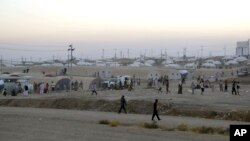 Người tị nạn Iraq tại trại Bajid Kandala ở thị trấn Feeshkhabour gần biên giới Syria, ngày 9/8/2014.