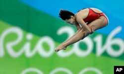 China's gold medalist Ren Qian competes during the women's 10-meter platform diving final in the Maria Lenk Aquatic Center at the 2016 Summer Olympics in Rio de Janeiro, Brazil, Aug. 18, 2016.