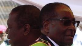 Zimbabwean President Robert Mugabe (R) and Prime Minister Morgan Tsvangirai in Harare, April 18, 2011.