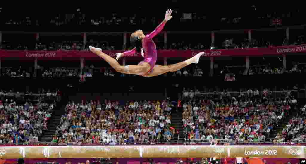 U.S. gymnast Gabrielle Douglas performs on the balance beam during the artistic gymnastics women's individual all-around competition.