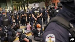 olice detain protesters, Wednesday, Sept. 23, 2020, in Louisville, Ky. A grand jury has indicted one officer on criminal charges six months after Breonna Taylor was fatally shot by police in Kentucky.