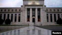 FILE - U.S. Federal Reserve building.