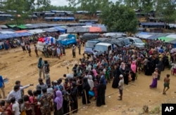 Newly arrived Rohingya refugees stand in a line to receive food rations in Kutupalong, Bangladesh, Sept. 30, 2017. As of Thursday, U.N. deputy spokesman Farhan Haq said, the U.N. and its humanitarian partners have received $36.4 million — just under half what was requested.
